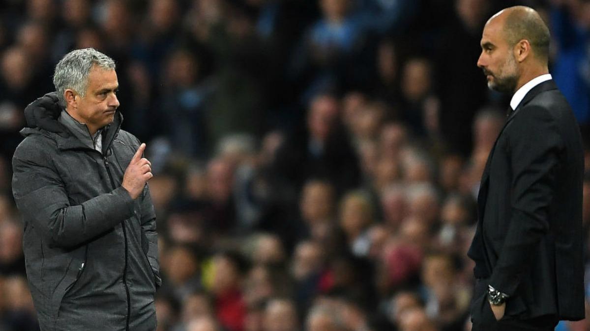 Mourinho y Guardiola durante la primera temporada en Manchester. (Getty Images)