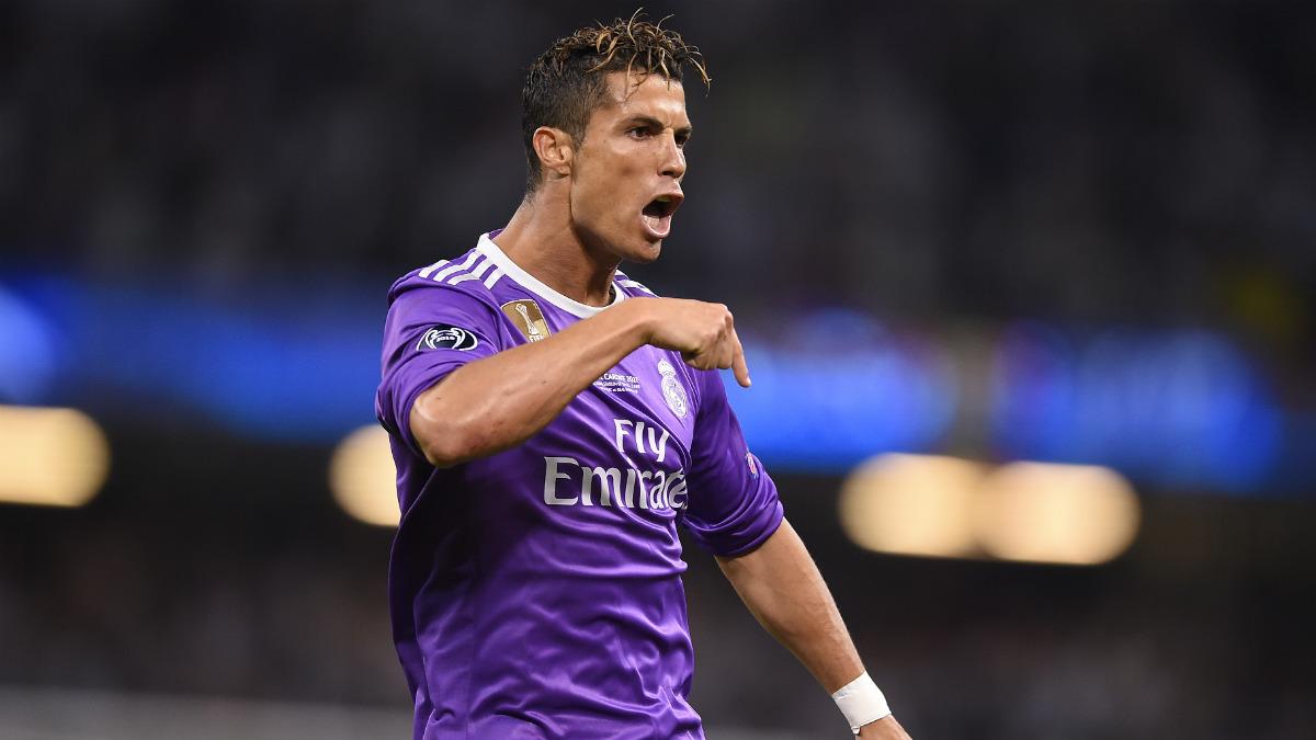 Cristiano Ronaldo celebra su tercer gol en una final de Champions distinta. (AFP)