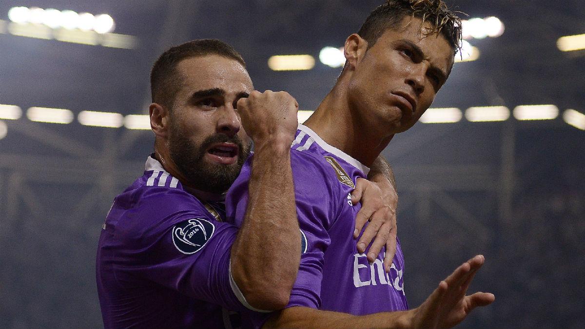 Cristiano y Carvajal celebran en Cardiff. (AFP)