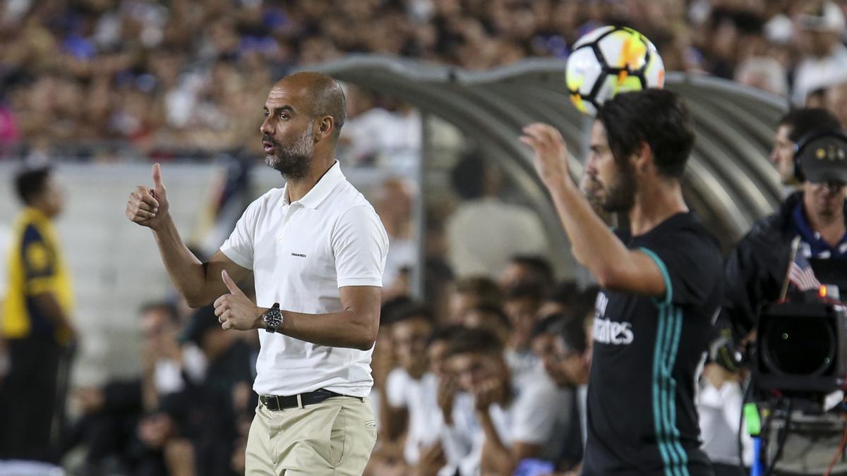 Guardiola, durante el amistoso ante el Real Madrid (AFP).
