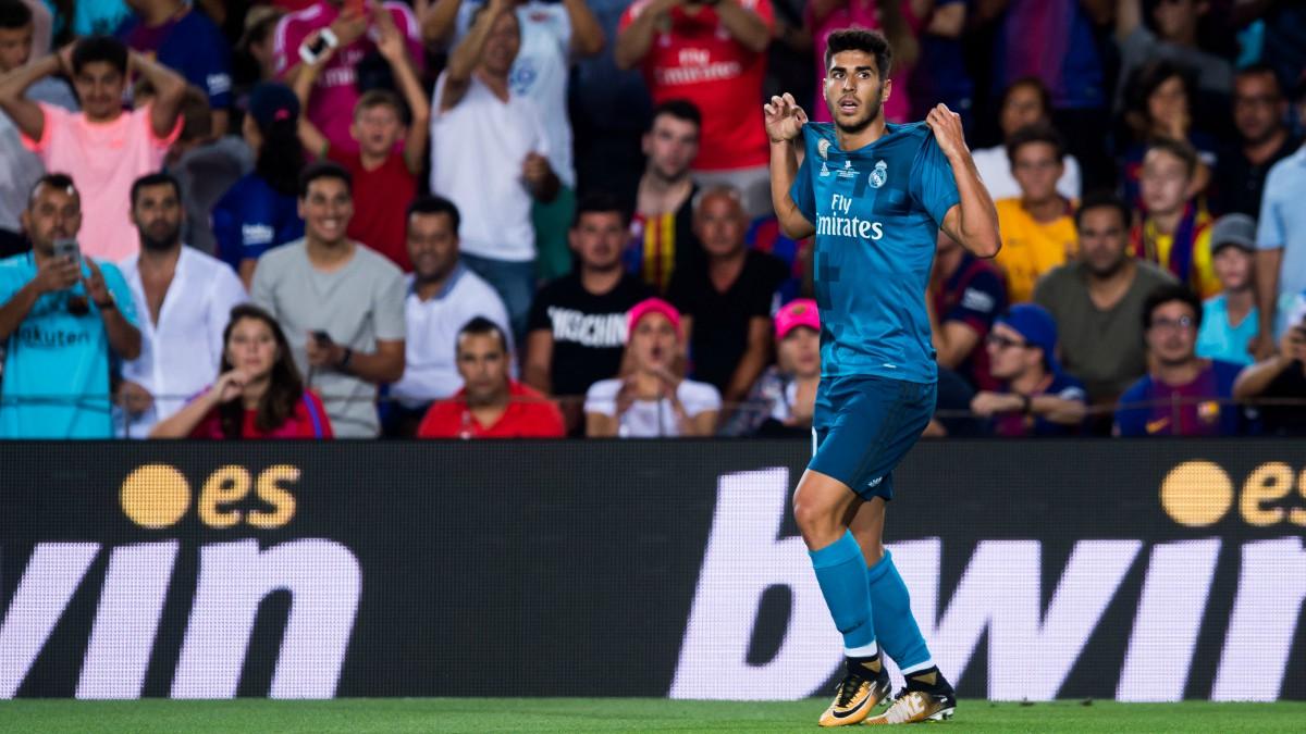 Marco Asensio celebra su golazo en el Camp Nou. (Getty)