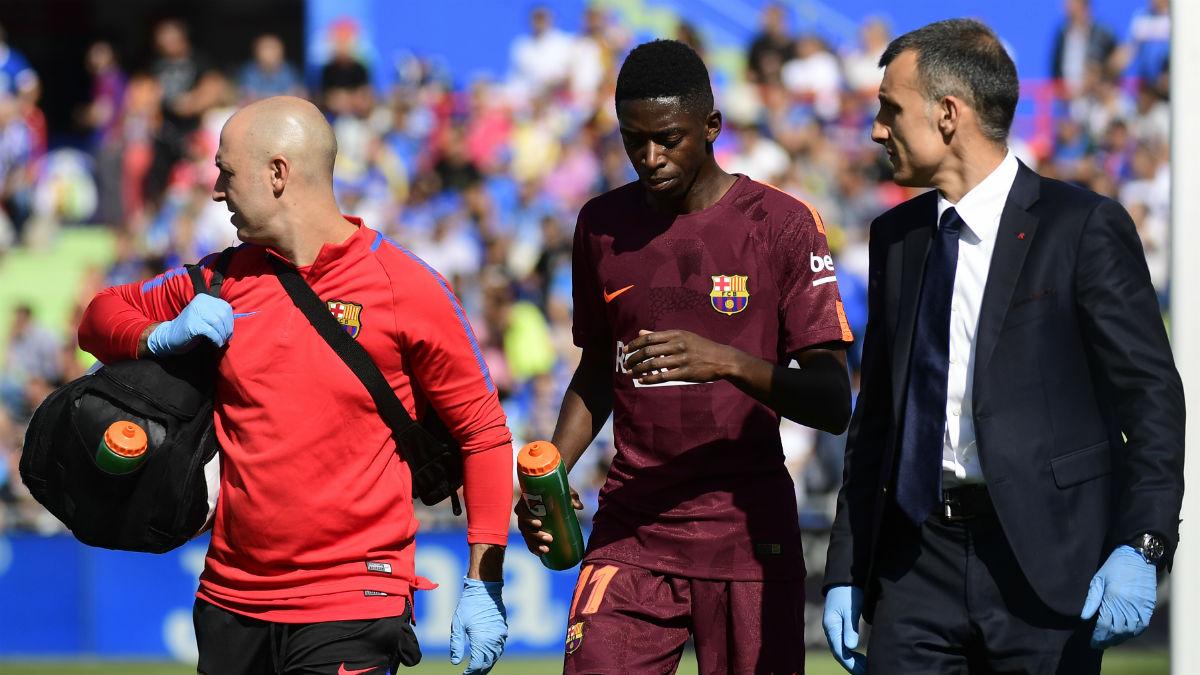 Dembélé se retira lesionado. (AFP)