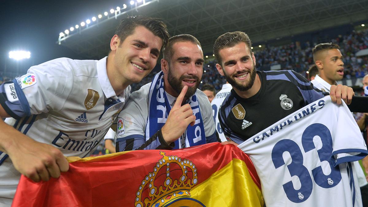 Nacho, Carvajal y Morata, celebrando la Liga en Málaga (Getty).