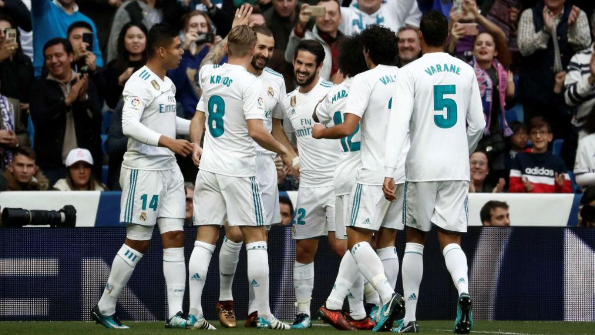 Los jugadores del Real Madrid celebran el primer gol de los madridistas ante el Málaga (Getty).