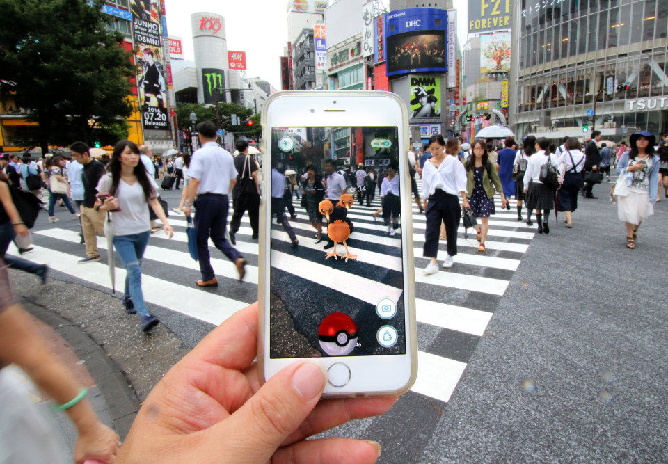 A fan tries out Pokemon Go in Tokyo's Shinjuku district on July 22, 2016, Tokyo, Japan. The Pokemon Go app finally arrived in the land of the Pokemon on Friday 22, July two weeks after its launch in the United States. The release of the app in Japan had been rumoured for the past few days after the leak of details of a partnership deal with McDonald's Japan to create Pokemon Gyms in its 3,000 locations. Nintendo's market value has almost doubled since the app created by Niantic first launched in America. Pictured: Pokemon Go players in Japan on arrival of app in Japan Ref: SPL1322474 220716 Picture by: Aflo / Splash News Splash News and Pictures Los Angeles: 310-821-2666 New York: 212-619-2666 London: 870-934-2666 photodesk@splashnews.com