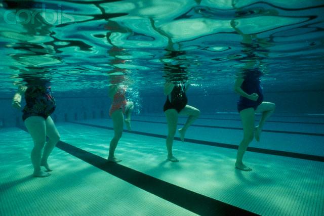 Pregnant Women Doing Aerobics in Swimming Pool