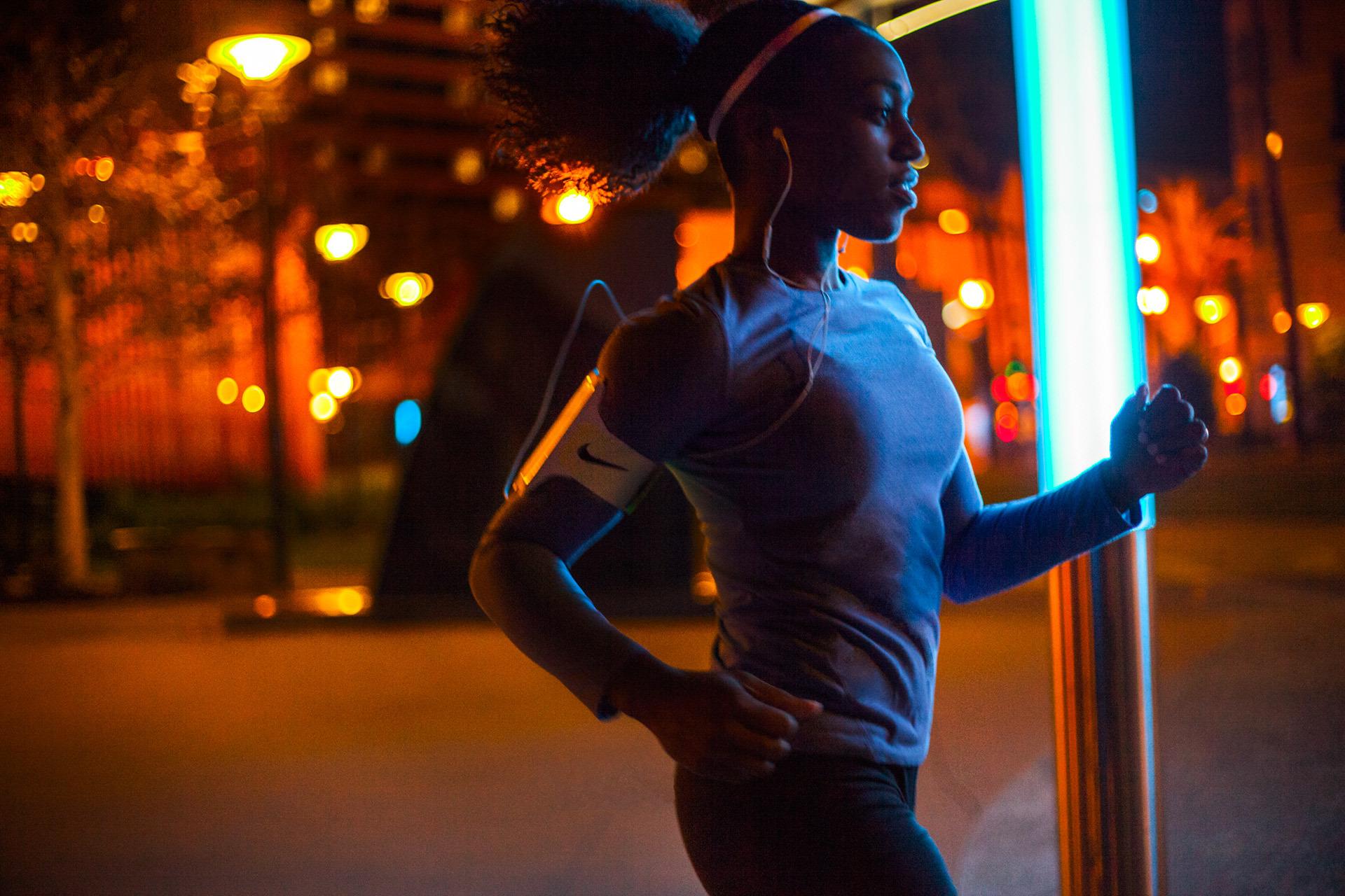 30's something female running through the city at night.
