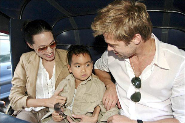Angelina Jolie con su hijo Maddox y Brad Pitt