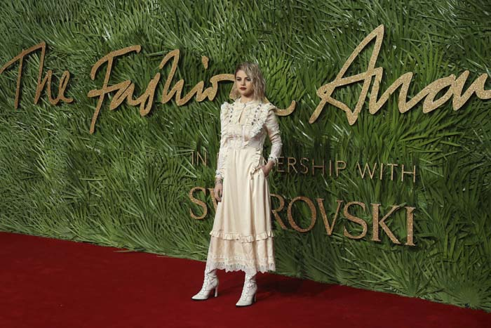 Singer Selena Gomez poses upon arrival at The British Fashion Awards 2017 in London, Monday, Dec. 4th, 2017.