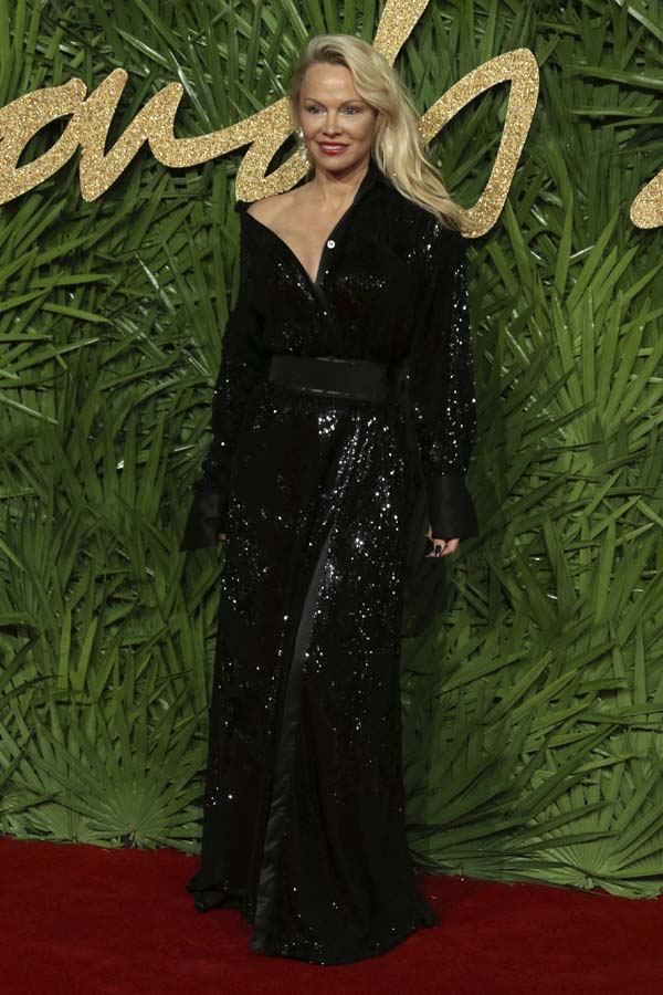 Pamela Anderson poses upon arrival at The British Fashion Awards 2017 in London, Monday, Dec. 4th, 2017.