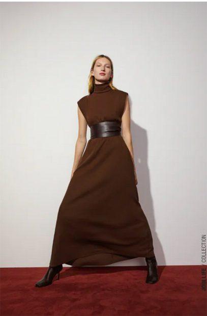 Vestido marrón con cinturón de Zara./Zara