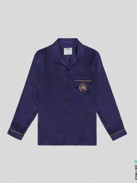Camisa satinada con las iniciales de C.Tangana grabadas en dorado./Bershka